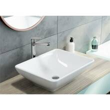 Single-hole basin mixer with raised base for top-mounted...